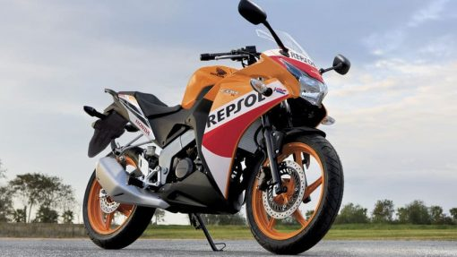 Honda CBR125R orange bike standing