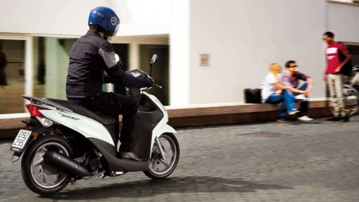 Honda Vision 50 and its scooter driver in Chelsea