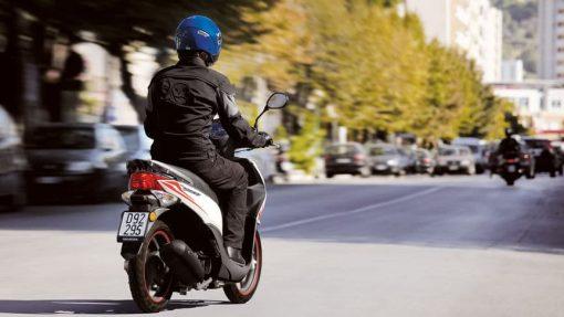 Honda Vision 50 riding on London streets