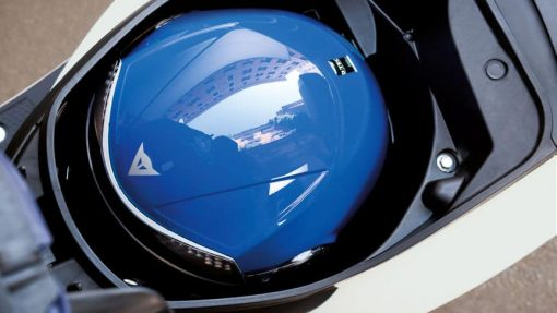 Honda Vision 50 scooter helmet place