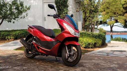 PCX125 scooter surrounded by trees