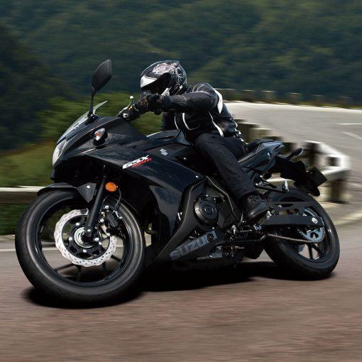 Suzuki GSX250R MotoGP sport motorbike with driver on way to London