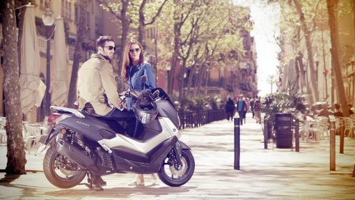 Yamaha NMAX stopped with man and woman