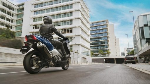 Yamaha T-MAX DX bike riding on London street