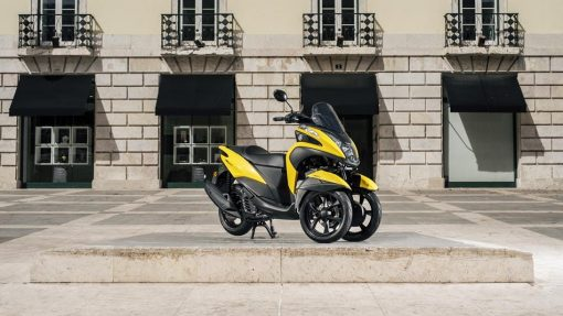 Yamaha Tricity 125 ABS scooter yellow parked