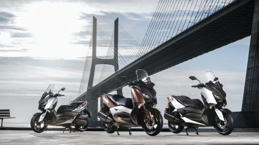 Yamaha X-MAX 300 3 scooters together standing near bridge