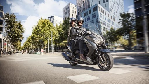 Yamaha X-MAX 400 rider and passenger in London