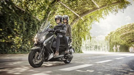 Yamaha X-MAX 400 scooter rider with passenger