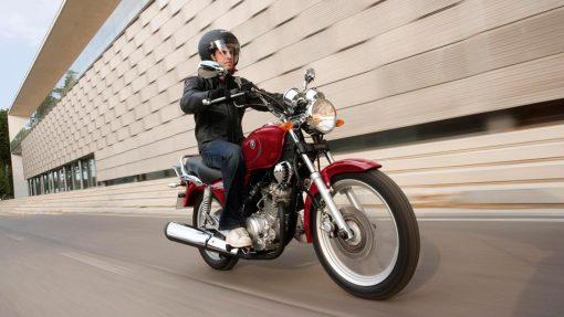 Yamaha YS 125 motorbike with biker