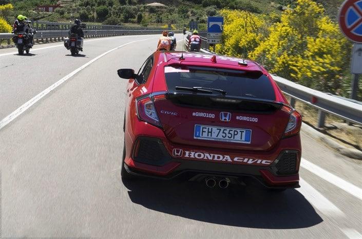 Honda Civic behind ready bikes