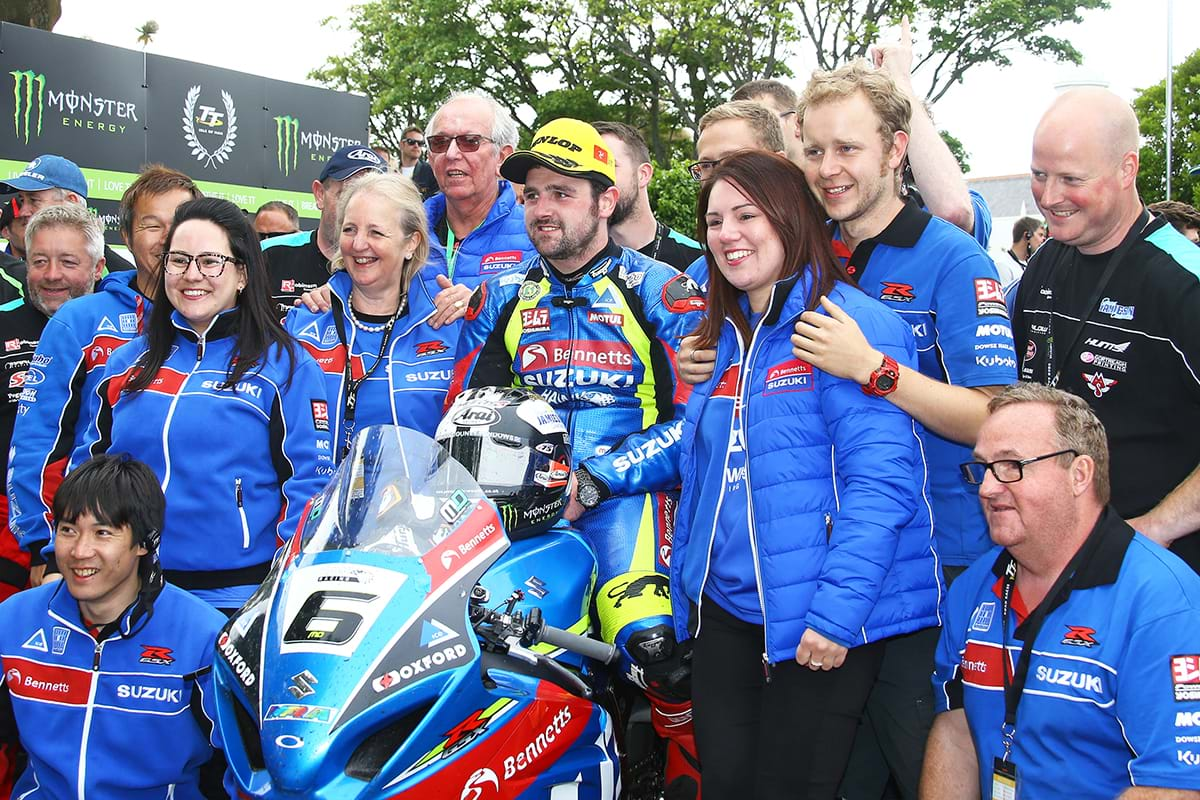 Michael Dunlop and his Suzuki GSX-R1000 surrounded by team