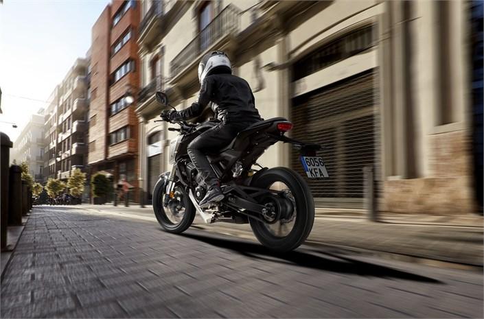 2018 Honda CB125R bike with driver in London