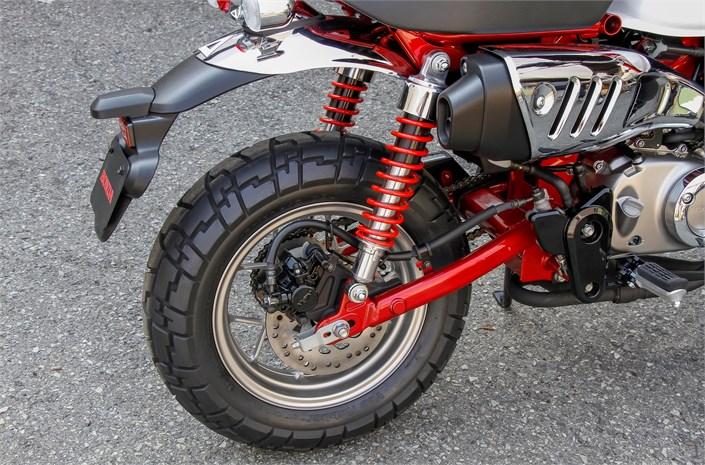 Honda Monkey motorcycle - Pearl Nebula Red/Ross White, rear wheel