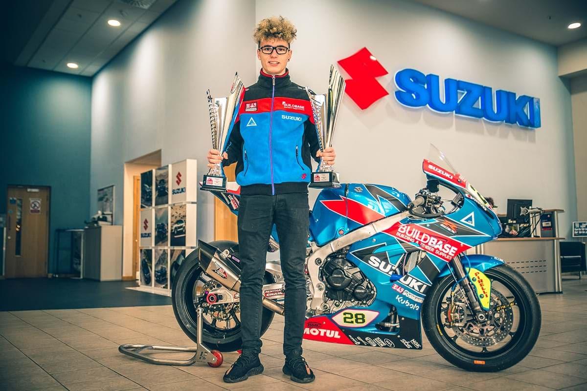 Bradley Ray with his Suzuki bike and winner's cups